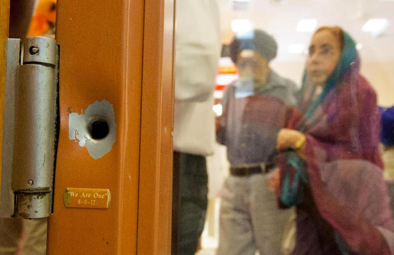 FILE - This Aug. 12, 2012 file photo shows a  bullet hole on a door frame inside the Sikh temple in Oak Creek, Wis. Frightening episodes of gun violence have been splayed across front pages with alarming frequency this campaign season: The movie theater killings in Colorado, the Sikh temple shootings in Wisconsin, the gun battle outside the Empire State Building, and more. Guns are used in two-thirds of homicides, according to the FBI. But the murder rate is less than half what it was two decades ago.   (AP Photo/Jeffrey Phelps, File)