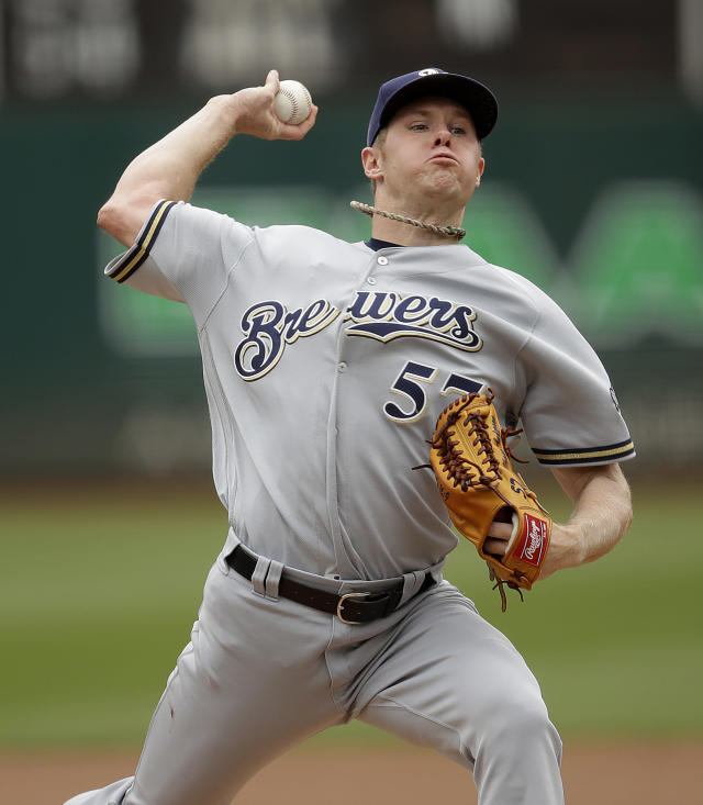 Milwaukee Brewers pitcher Chase Anderson works against the Oakland Athletics in the first inning of a baseball game Thursday, Aug. 1, 2019, in Oakland, Calif. (AP Photo/Ben Margot)
