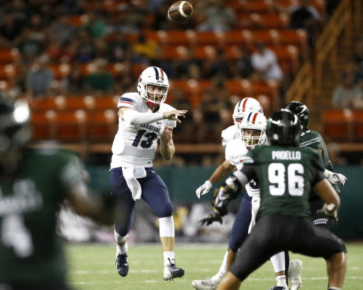 Duquesne quarterback Daniel Parr (13) makes a pass over Hawaii during the third quarter of an NCAA college football game Saturday, Sept. 22, 2018, in Honolulu. (AP Photo/Marco Garcia)