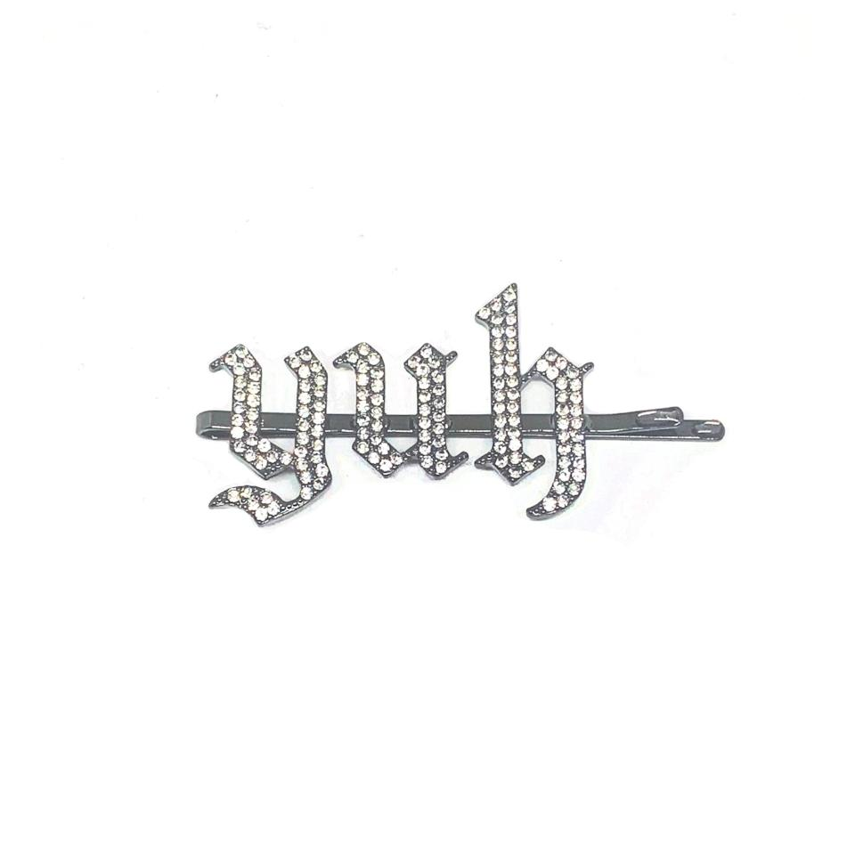 <p>If they love to accessorize, they'll absolutely obsess over this <span>Ariana Grande Sweetener YUH Prive Rhinestone Hair Pin</span> ($20). It's the perfect accessory for that slicked back high pony. </p>