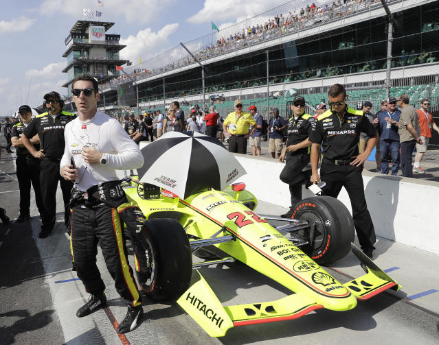 Simon Pagenaud, front left, of France, waits during qualifications for the IndyCar Indianapolis 500 auto race at Indianapolis Motor Speedway in Indianapolis, Sunday, May 20, 2018. (AP Photo/Darron Cummings)