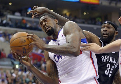 Brooklyn Nets forward Reggie Evans, right, pressures Los Angeles Clippers center DeAndre Jordan during the first half of their NBA basketball game, Saturday, March 23, 2013, in Los Angeles. (AP Photo/Mark J. Terrill)