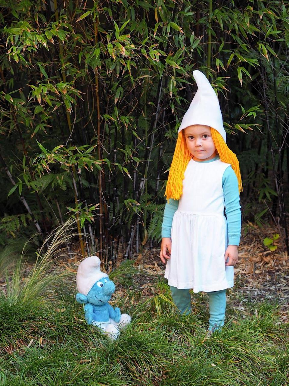 """<p>The smurfs may have found their way into our hearts in the '80s, but these lovable blue buddies are still just as popular with kids today. Follow this easy tutorial for a last-minute costume your child will love!</p><p><strong>See more at <a href=""""http://www.littlehiccups.net/2017/10/last-minute-halloween-diy-smurf-costume.html"""" rel=""""nofollow noopener"""" target=""""_blank"""" data-ylk=""""slk:Little Hiccups"""" class=""""link rapid-noclick-resp"""">Little Hiccups</a>. </strong></p><p><a class=""""link rapid-noclick-resp"""" href=""""https://go.redirectingat.com?id=74968X1596630&url=https%3A%2F%2Fwww.walmart.com%2Fip%2FRed-Heart-Super-Saver-Desert-Camouflage-Yarn-1-Each%2F17209246&sref=https%3A%2F%2Fwww.thepioneerwoman.com%2Fholidays-celebrations%2Fg32645069%2F80s-halloween-costumes%2F"""" rel=""""nofollow noopener"""" target=""""_blank"""" data-ylk=""""slk:SHOP YELLOW YARN"""">SHOP YELLOW YARN</a></p>"""