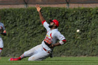 St. Louis Cardinals right fielder Dexter Fowler (25) tries to make a play on a single hit by Chicago Cubs' Nico Hoerner during the seventh inning of a baseball game Friday, Sept. 20, 2019, in Chicago. (AP Photo/Matt Marton)