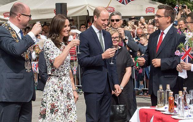 The royals were seen taking a shot during a visit to a market place. Photo: Getty