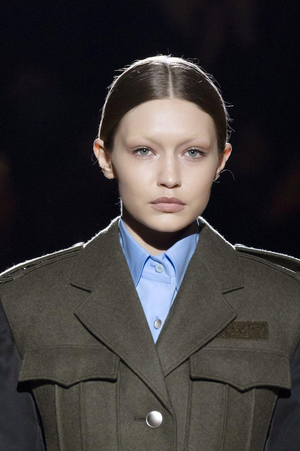 <p>You know the old saying 'the brows are the frame of your face'? Well when you're Gigi Hadid and have been blessed with the bone structure of a Grecian sculpture, you can look incredible with or without them (seriously, look at that brow bone). While the transformation was only temporary for the Prada AW19 show, Hadid's barely-there look shows just how much a bleached brow can transform your face. </p>