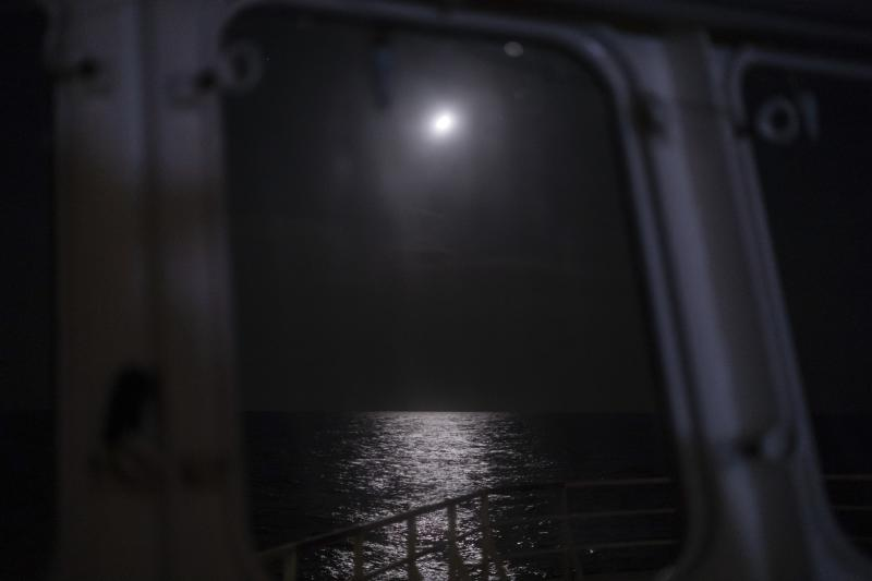 "In this Sept. 7, 2019 photo, moonlight reflects from the surface of Mediterranean Sea off the coast of Libya. Husni Bey, a prominent Libyan businessman, said the idea of Europe sending aid money to Libya, a once-wealthy country suffering from corruption, was ill-conceived from the beginning. ""Europe wants to buy those who can stop smuggling with all of these programs,"" Bey said. ""They would be much better off blacklisting the names of those involved in human trafficking, fuel and drug smuggling and charging them with crimes, instead of giving them money."" (AP Photo/Renata Brito)"