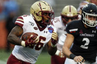 Boston College running back David Bailey (26) carries the ball against Cincinnati during the first half of the Birmingham Bowl NCAA college football game Thursday, Jan. 2, 2020, in Birmingham, Ala. (AP Photo/Butch Dill)