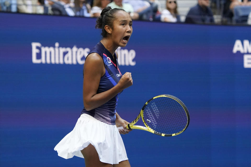 Leylah Fernandez, of Canada, reacts after scoring a point against Emma Raducanu, of Britain, during the women's singles final of the US Open tennis championships, Saturday, Sept. 11, 2021, in New York. (AP Photo/Elise Amendola)