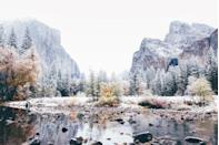 <p>This view of Yosemite after a snowfall shows just how chilly it can get in the park during winter months. Here, a frozen Yosemite Valley is shown with the Merced River and El Capitan and Bridalveil Falls in the background. </p>