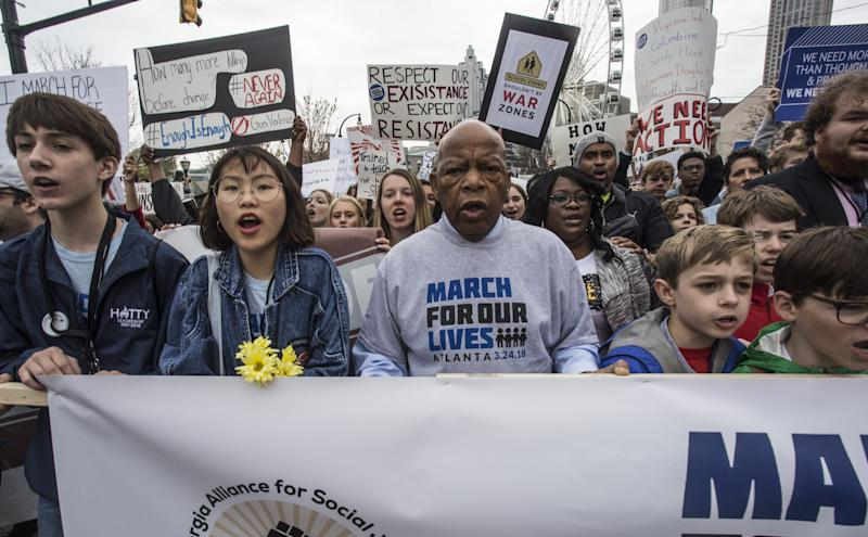 U.S. Rep. John Lewis leads a march of thousands through the streets of Atlanta on Saturday.
