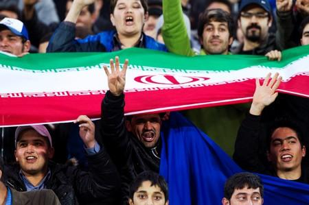 FILE PHOTO: Fans of Esteghlal cheer during their AFC Champions League  soccer match playoff against Al Ittifaq, in Tehran