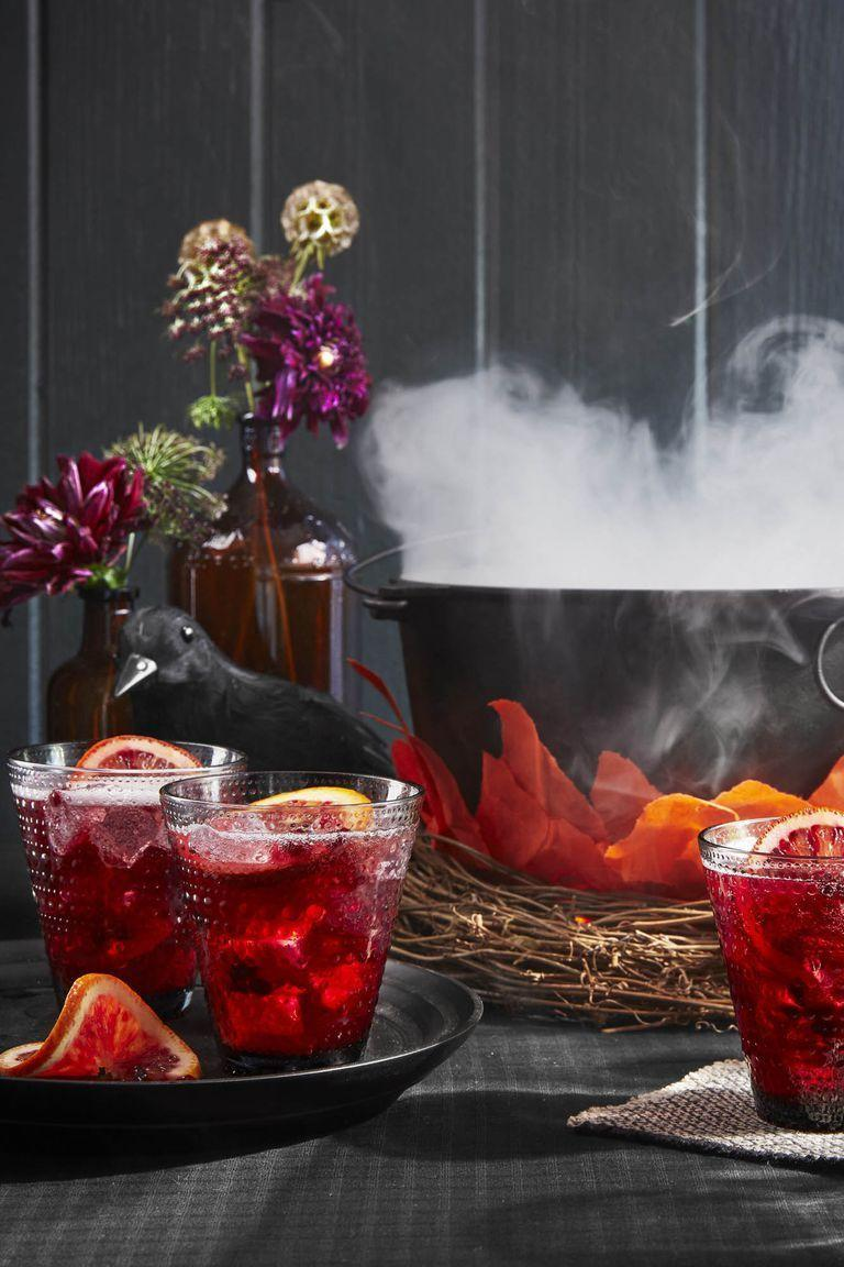 """<p>This punch includes spiced rum and prosecco for a refreshing kick. </p><p><em>Get the recipe from <a href=""""https://www.countryliving.com/food-drinks/a23390880/pomegranate-rum-punch-recipe/"""" rel=""""nofollow noopener"""" target=""""_blank"""" data-ylk=""""slk:Country Living"""" class=""""link rapid-noclick-resp"""">Country Living</a>.</em></p>"""