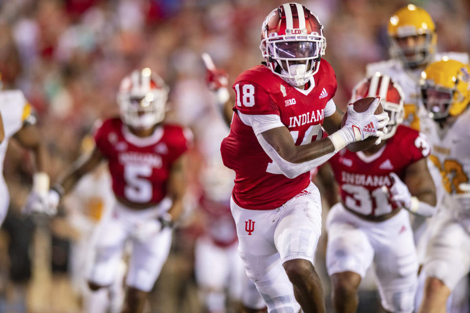 Indiana defensive lineman Jonathan King (18) runs the ball into the end zone to score after recovering a blocked Idaho punt during the first half of an NCAA college football game, Saturday, Sept. 11, 2021, in Bloomington, Ind. (AP Photo/Doug McSchooler)