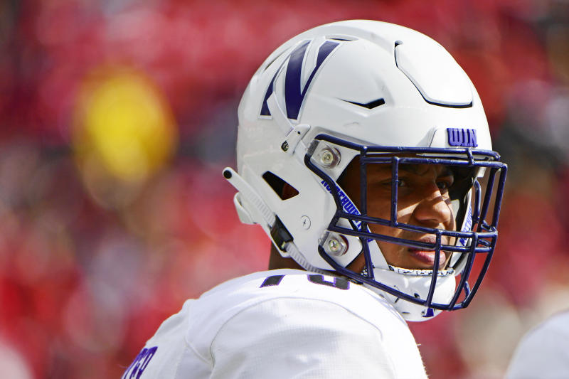 Rashawn Slater looks on during a timeout of a Northwestern game.