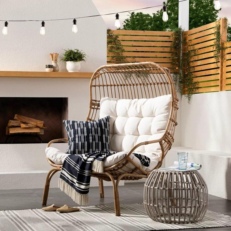 <p>The <span>Wicker and Metal Patio Egg Chair</span> ($550) is so large, it can almost fit two people. </p>
