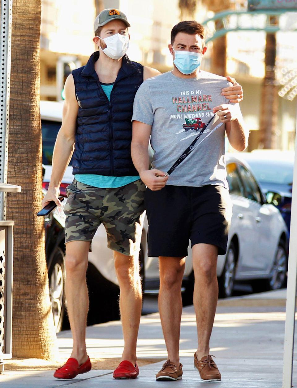 <p>Newly engaged couple Jonathan Bennett and James Vaughan go for a stroll after enjoying lunch in Palm Springs on Wednesday.</p>