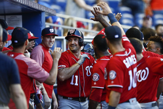 Washington Nationals' Ryan Zimmerman (11) celebrates in the dugout hitting a home run during the ninth inning of a baseball game against the Miami Marlins on Sunday, April 21, 2019, in Miami. (AP Photo/Brynn Anderson)