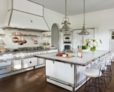 """<p>At this Palm Beach home designed by Susan Zises Green, the fully-equipped kitchen by <a href=""""https://officinegullo.com/en/"""" rel=""""nofollow noopener"""" target=""""_blank"""" data-ylk=""""slk:Officine Gullo"""" class=""""link rapid-noclick-resp"""">Officine Gullo</a>—including cabinetry and such appliances as a pizza oven—has a vintage European feel. Barstools are by BK Antiques.</p>"""