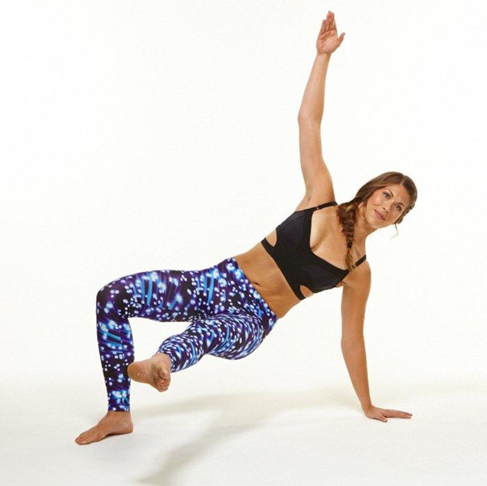 """<p>""""This exercise not only tones those obliques but also gets your heart rate up by adding some cardio, which will help you shed extra layers and reveal your waistline faster,"""" says Jenn Seracuse, director of Pilates at <a href=""""http://www.flexstudios.com/"""" target=""""_blank"""">FLEX Studios</a> (and the model demonstrating these oblique workout moves).</p> <p><strong>A.</strong> Start in on all fours with knees underneath the hips and wrists underneath shoulders. Exhale to engage the abs and lift the knees to a hover off the mat.</p> <p><strong>B. </strong>Kick the right leg under body and across to the left as you rotate hips to the left and drop left heel to the mat. Simultaneously, reach left arm up. Return to all fours and hover. Do as many reps as possible for 30 seconds. Repeat on opposite side.</p>"""