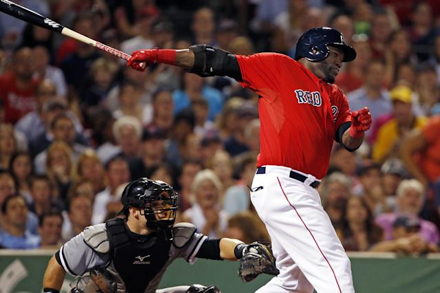 Boston Red Sox designated hitter David Ortiz, right, hits a two-run single as Chicago White Sox catcher Josh Phegley watches during the fourth inning of a baseball game at Fenway Park in Boston, Friday, Aug. 30, 2013. (AP Photo/Elise Amendola)