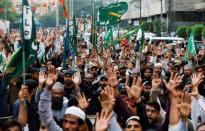 FILE PHOTO: People chant slogans against the satirical French weekly newspaper Charlie Hebdo, which reprinted a cartoon of the Prophet Mohammad, during a protest in Karachi