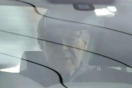 Cardinal George Pell is driven from prison after being released