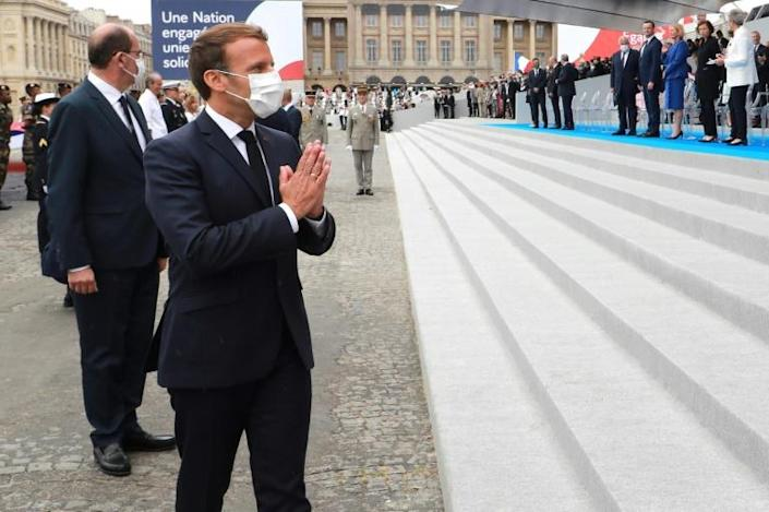 French President Emmanuel Macron, who oversaw drastically downsized Bastille Day celebrations due to the coronavirus, said he would like to make masks mandatory in enclosed public spaces (AFP Photo/Ludovic Marin)