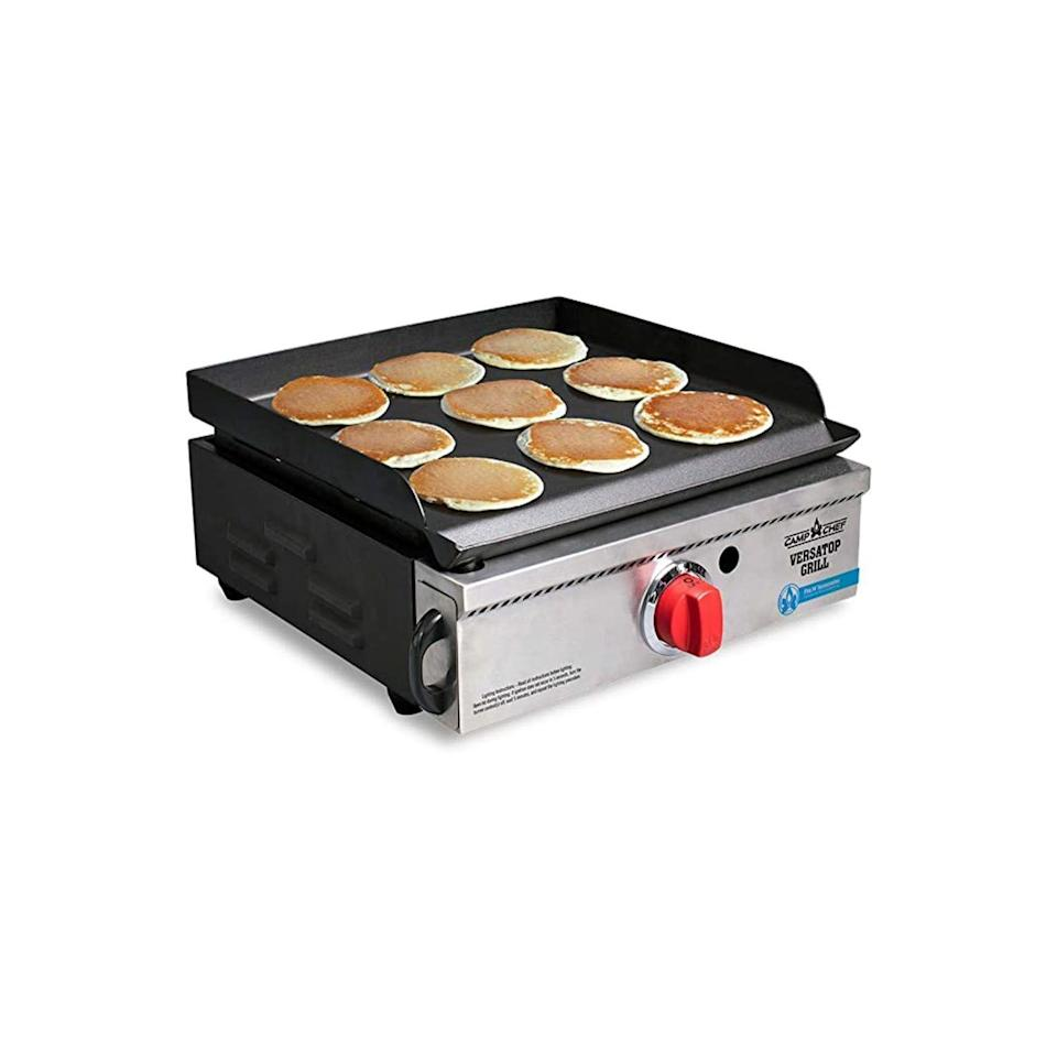 """<p><strong>Camp Chef</strong></p><p>amazon.com</p><p><strong>$232.73</strong></p><p><a href=""""https://www.amazon.com/dp/B07J2RT8PK?tag=syn-yahoo-20&ascsubtag=%5Bartid%7C2164.g.36556929%5Bsrc%7Cyahoo-us"""" rel=""""nofollow noopener"""" target=""""_blank"""" data-ylk=""""slk:Shop Now"""" class=""""link rapid-noclick-resp"""">Shop Now</a></p><p>This griddle/grill is a little pricey, but worth the investment if you want to make some serious meals like <a href=""""https://www.thepioneerwoman.com/food-cooking/recipes/a11442/perfect-pancakes/"""" rel=""""nofollow noopener"""" target=""""_blank"""" data-ylk=""""slk:Ree Drummond's perfect pancakes"""" class=""""link rapid-noclick-resp"""">Ree Drummond's perfect pancakes</a> and <a href=""""https://www.thepioneerwoman.com/food-cooking/cooking-tips-tutorials/g36146667/best-burger-toppings/"""" rel=""""nofollow noopener"""" target=""""_blank"""" data-ylk=""""slk:toppings-loaded burgers"""" class=""""link rapid-noclick-resp"""">toppings-loaded burgers</a> in the wild! Keep in mind you'll have to bring along an additional stove for any meals that require boiling. </p>"""