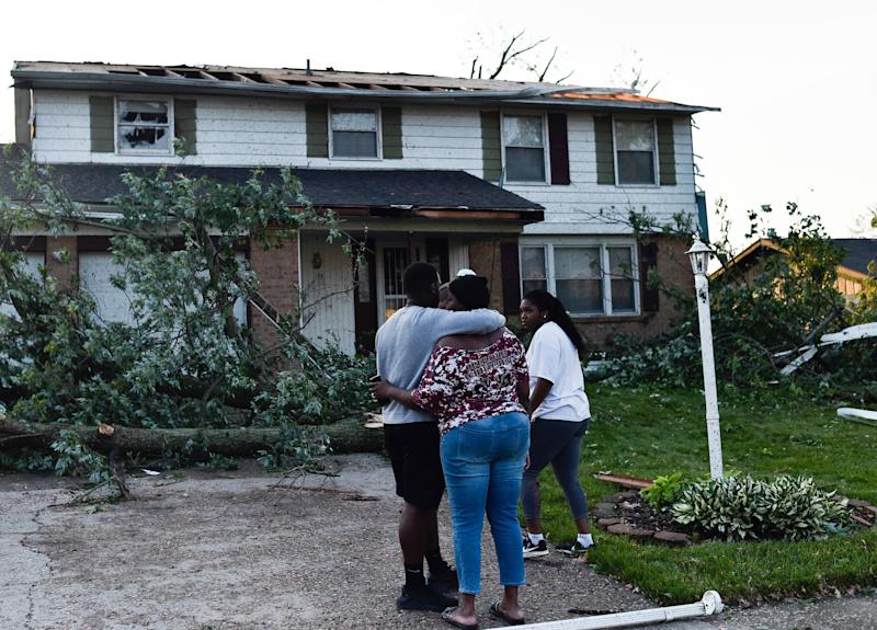 Residents of the West Brook neighborhood of Trotwood, Ohio, inspect the damage to their homes following powerful tornadoes on May 28.
