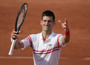 Serbia's Novak Djokovic celebrates towards the crowd after defeating Uruguay's Pablo Cuevas in their second round match on day 5, of the French Open tennis tournament at Roland Garros in Paris, France, Thursday, June 3, 2021. (AP Photo/Christophe Ena)