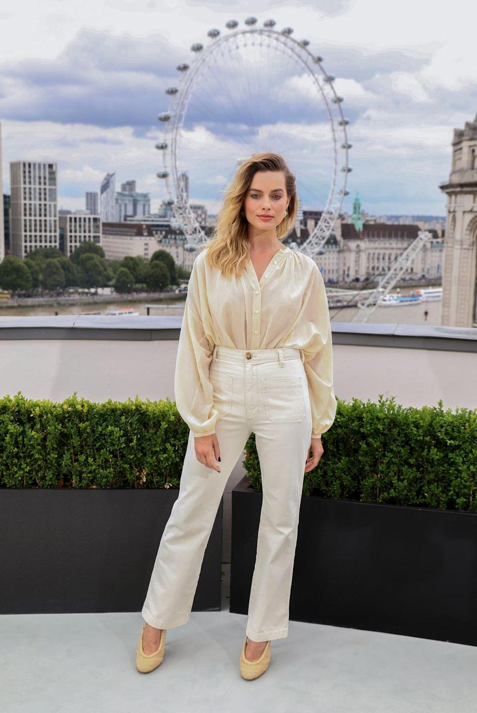 <p>For the London photocall, Margot chose a sophisticated cream outfit</p>
