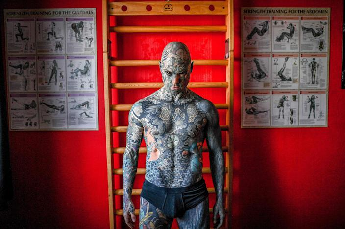 French primary school teacher and tattoo enthusiast Sylvain Helaine, known as Freaky Hoody, poses during a photo session in Palaiseau, a south of Paris suburb, on September 22, 2020.