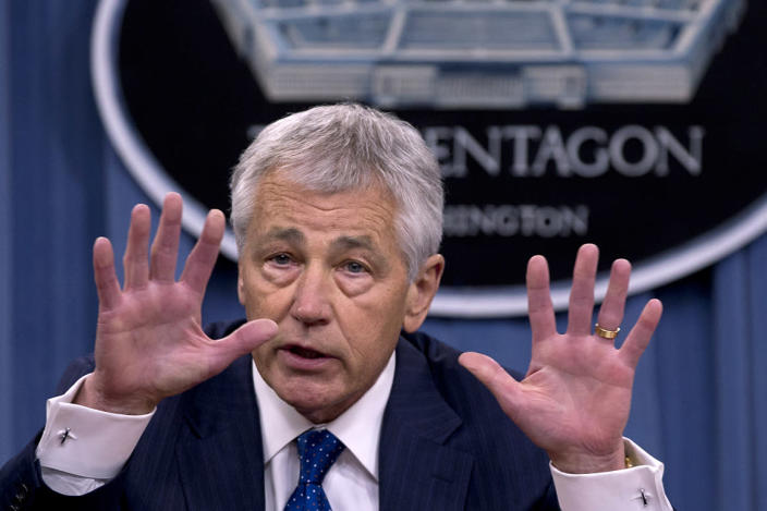 Defense Secretary Chuck Hagel gestures as he speaks during a news conference at the Pentagon, Wednesday, April 10, 2013, about the fiscal year 2014 defense budget. (AP Photo/Carolyn Kaster)