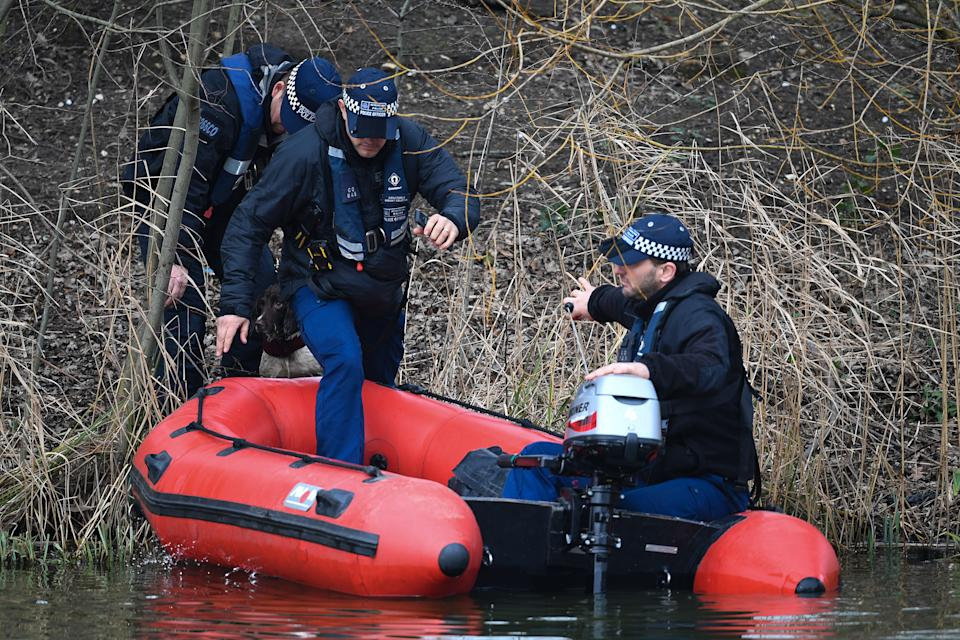 Police in a boat with a sniffer dog search Mount Pond on Clapham Common for missing woman Sarah Everard.