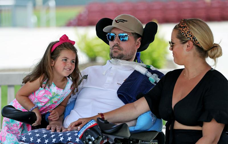 Pete Frates with his 4-year-old daughter Lucy and wife Julie by his side.