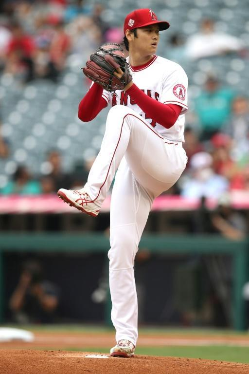 Shohei Ohtani's performances on the mound and at the plate have drawn comparisons with Babe Ruth (AFP/Katharine Lotze)