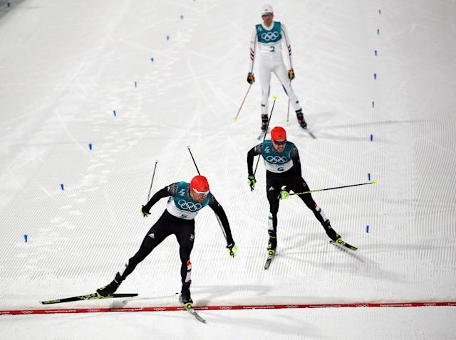 Nordic Combined Events - Pyeongchang 2018 Winter Olympics - Men's Individual 10 km Final - Alpensia Cross-Country Skiing Centre - Pyeongchang, South Korea - February 20, 2018 - Johannes Rydzek of Germany crosses the finish line to win gold ahead of silver medalist Fabian Riessle of Germany. REUTERS/Carlos Barria TPX IMAGES OF THE DAY