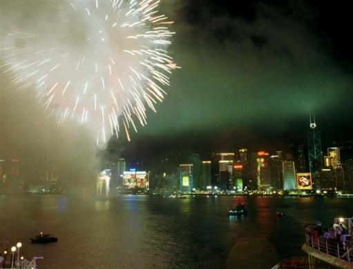 Fireworks explode over the sky-line of Hong Kong Island and Victoria Harbour June 30 to mark the end of Britain's colonial rule in the territory.