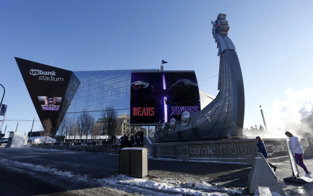 Fans walk outside U.S. Bank Stadium before an NFL football game between the Minnesota Vikings and the Chicago Bears, Sunday, Dec. 31, 2017, in Minneapolis. (AP Photo/Bruce Kluckhohn)