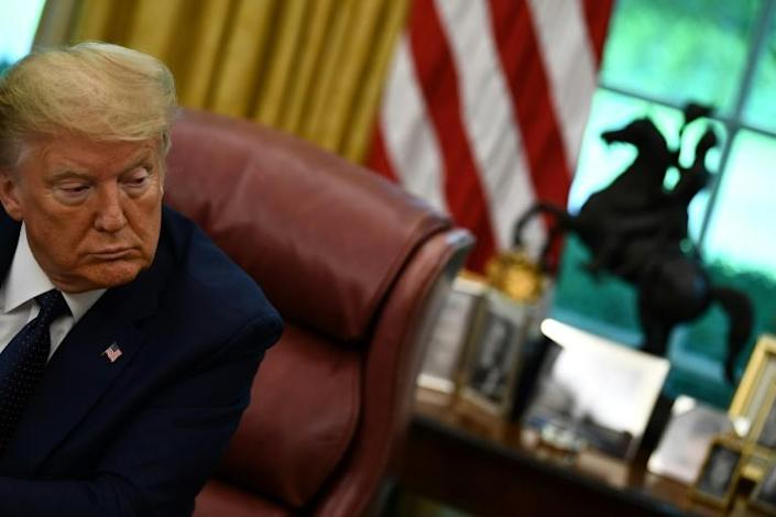 US President Donald Trump signed an order this week calling for more oversight of social media platforms despite questions about whether the measure could be enforced (AFP Photo/Brendan Smialowski)