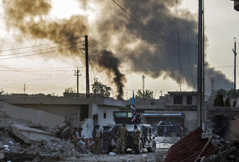 Masters of invention, IS jihadists have booby trapped household appliances and turned cars into armoured suicide bombs as they try to stymy the Iraqi forces (AFP Photo/Odd Andersen)