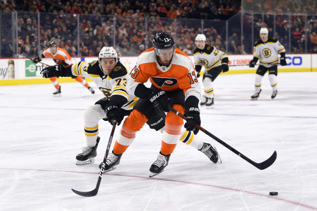 Philadelphia Flyers' Kevin Hayes, right, keeps the puck from Boston Bruins' Charlie McAvoy during the second period of an NHL hockey game, Monday, Jan. 13, 2020, in Philadelphia. (AP Photo/Derik Hamilton)