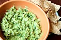 """<p>One of <a href=""""https://www.thedailymeal.com/entertain/win-game-day-these-21-irresistible-dips-slideshow?referrer=yahoo&category=beauty_food&include_utm=1&utm_medium=referral&utm_source=yahoo&utm_campaign=feed"""" rel=""""nofollow noopener"""" target=""""_blank"""" data-ylk=""""slk:our all-time favorite dips"""" class=""""link rapid-noclick-resp"""">our all-time favorite dips</a>, guacamole is a summertime must. Whether you serve it with tortilla chips as a side or appetizer or choose to put a couple of spoonfuls on your <a href=""""https://www.thedailymeal.com/recipes/grilled-mahi-mahi-tacos-spicy-mayo-recipe?referrer=yahoo&category=beauty_food&include_utm=1&utm_medium=referral&utm_source=yahoo&utm_campaign=feed"""" rel=""""nofollow noopener"""" target=""""_blank"""" data-ylk=""""slk:grilled fish tacos"""" class=""""link rapid-noclick-resp"""">grilled fish tacos</a>, you can't go wrong with this fresh guac recipe.</p> <p><a href=""""https://www.thedailymeal.com/guacamole-0-recipe?referrer=yahoo&category=beauty_food&include_utm=1&utm_medium=referral&utm_source=yahoo&utm_campaign=feed"""" rel=""""nofollow noopener"""" target=""""_blank"""" data-ylk=""""slk:For the Fresh Guacamole recipe, click here."""" class=""""link rapid-noclick-resp"""">For the Fresh Guacamole recipe, click here.</a></p>"""