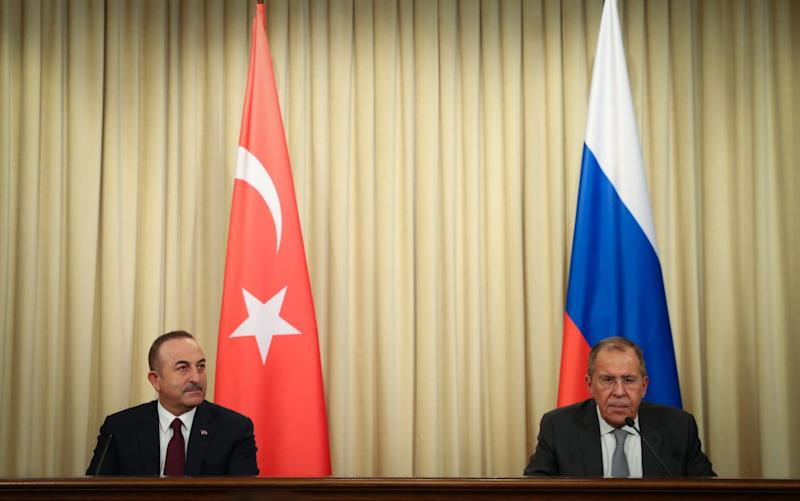 Turkish Foreign Minister Mevlut Cavusoglu and Russian Foreign Minister Sergey Lavrov hold a press conference following the marathon meeting - Anadolu