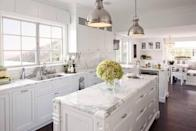 "<p>But all it took was a sleek, <a href=""https://www.housebeautiful.com/room-decorating/kitchens/a2058/make-a-room-look-larger-makeover-elle-decor/"" rel=""nofollow noopener"" target=""_blank"" data-ylk=""slk:white design"" class=""link rapid-noclick-resp"">white design</a> to make it feel twice as big. The marble island countertop and backsplash perfectly complement the silver accessories.</p>"