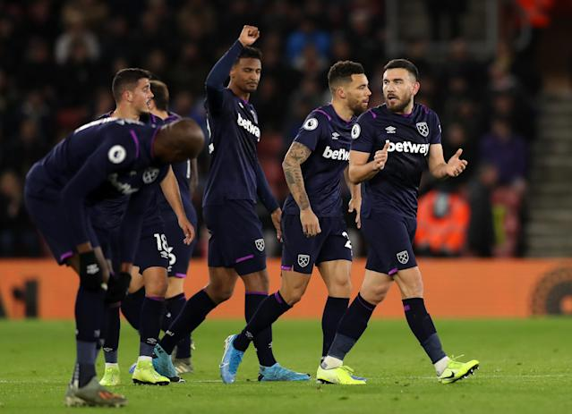 Sebastien Haller of West Ham United celebrates with teammates after scoring his team's first goal. (Credit: Getty Images)