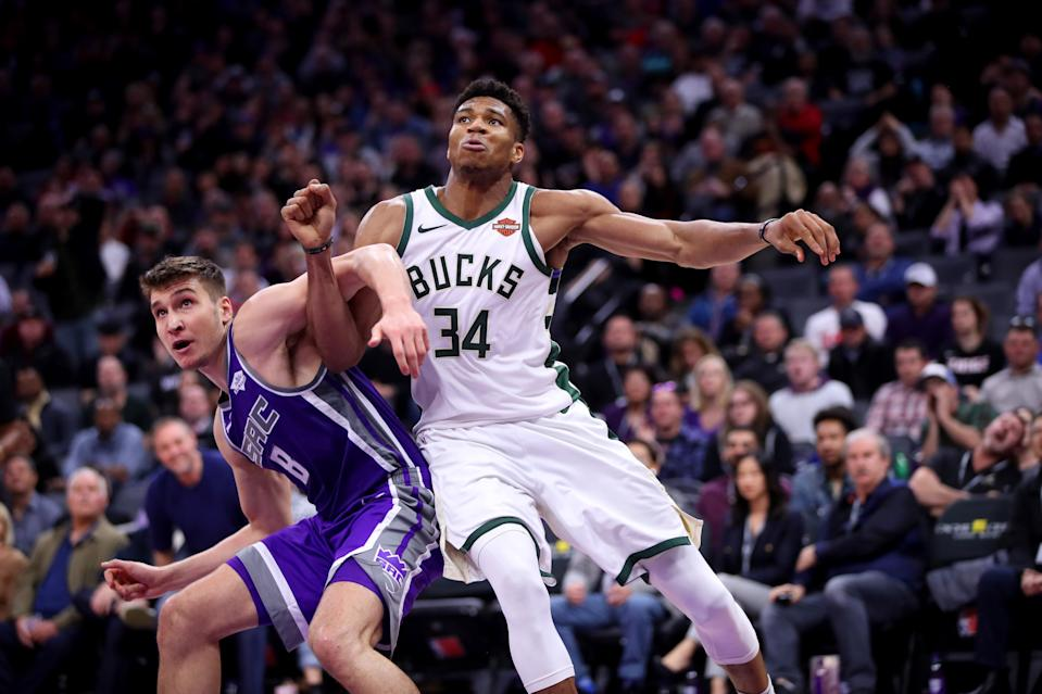 Feb 27, 2019; Sacramento, CA, USA; Milwaukee Bucks forward Giannis Antetokounmpo (34) battles for position with Sacramento Kings guard Bogdan Bogdanovic (8) in the fourth quarter at the Golden 1 Center. Mandatory Credit: Cary Edmondson-USA TODAY Sports