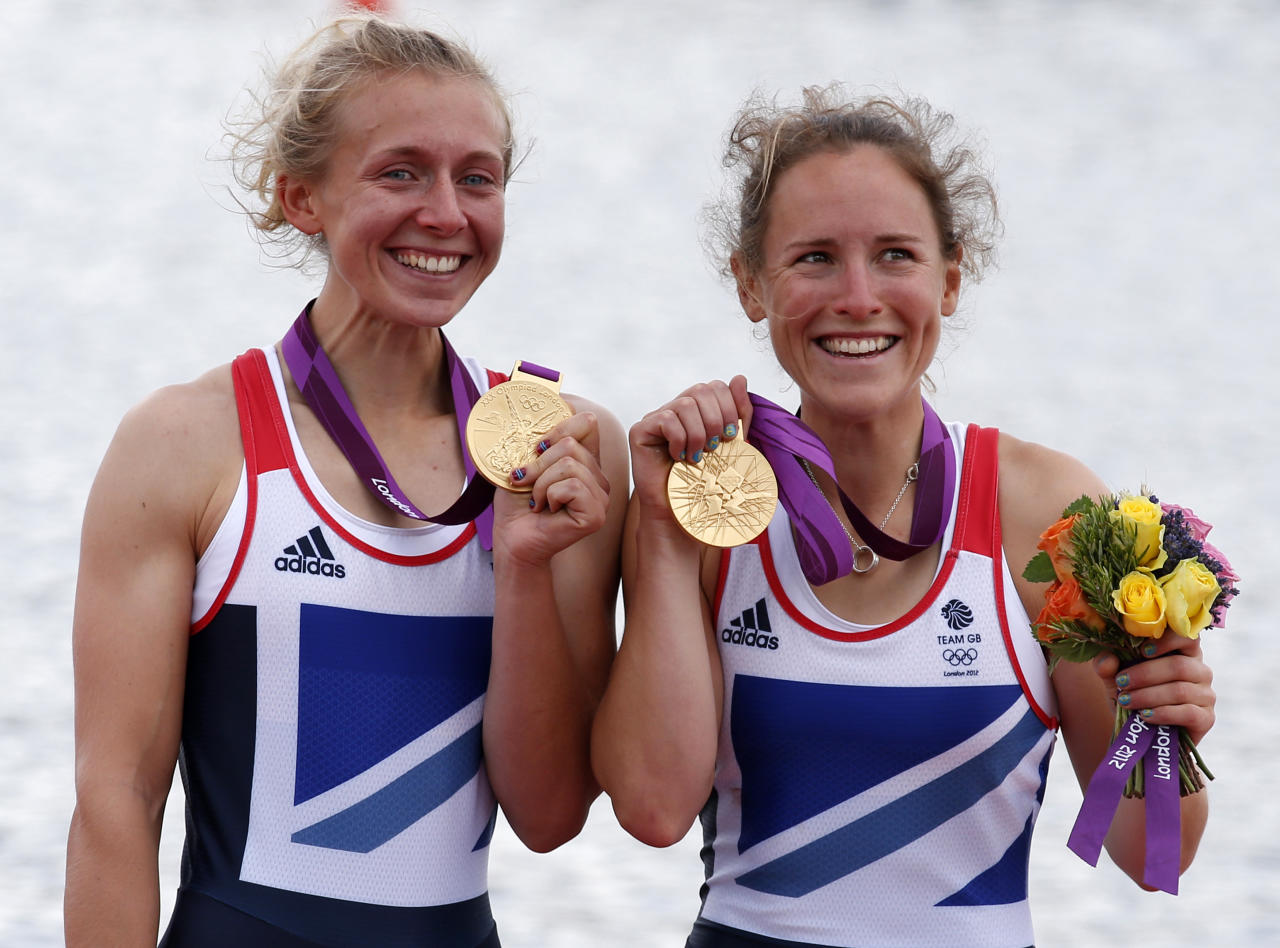 Gold medallists Katherine Copeland (L) and Sophie Hosking of Britain celebrate during the medal ceremony for the women's lightweight double sculls final in the rowing event during the London 2012 Olympic Games at Eton Dorney August 4, 2012.  REUTERS/Jim Young (BRITAIN - Tags: SPORT ROWING OLYMPICS)