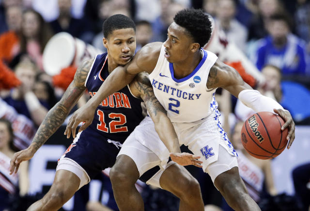 Kentucky's Ashton Hagans (2) tries to get past Auburn's J'Von McCormick (12) during the first half of the Midwest Regional final game in the NCAA men's college basketball tournament Sunday, March 31, 2019, in Kansas City, Mo. (AP Photo/Charlie Riedel)